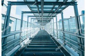 Фотообои Лестница в тоннеле из стекла